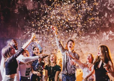 friends-having-fun-in-falling-confetti_23-2147651884